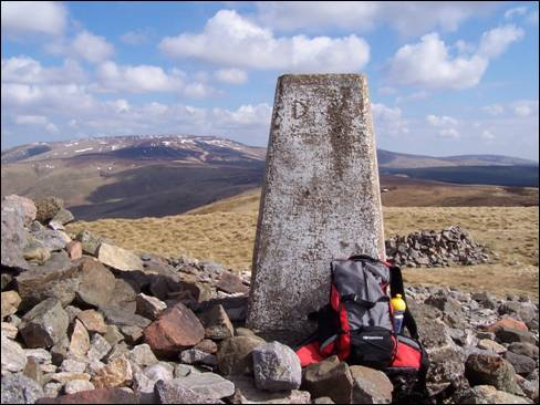 Windy Gyle summit and a distant Cheviot